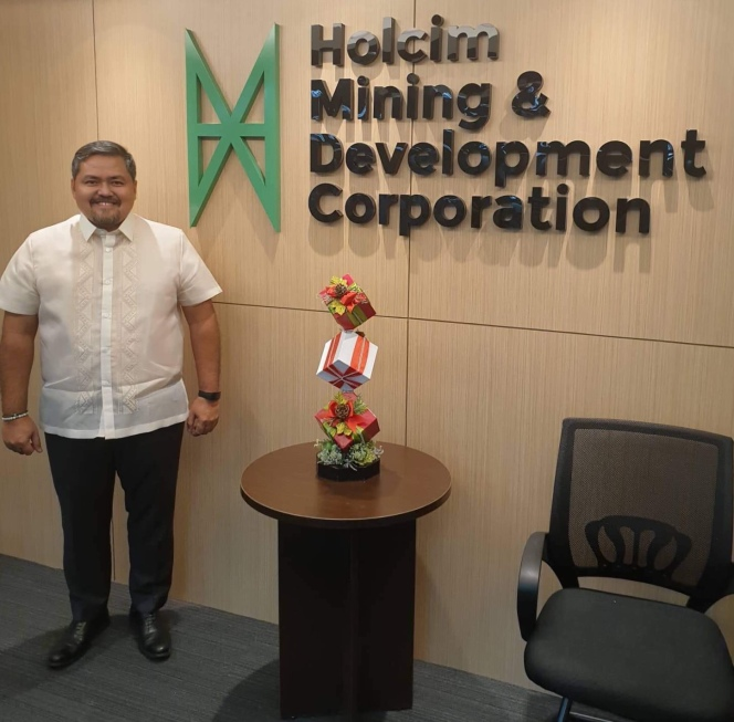 Rey Baja in the Holcim MDC Office