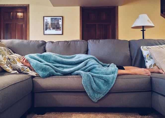 Sick person covered in blanket. Image from Pexels.